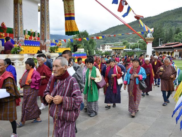 Bhutanese People In Traditional Garb Outside National Memorial Chorten